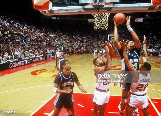 Georgetown's Alonzo Mournng goes up strong to the hole against the University of Connecticut Hartford Connecticut 1990