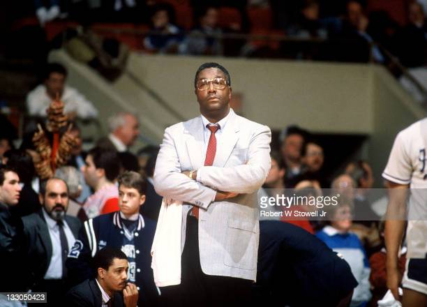 Georgetown's coach John Thompson looks on with arms crossed, during a game against UConn, at Hartford CT 1990.