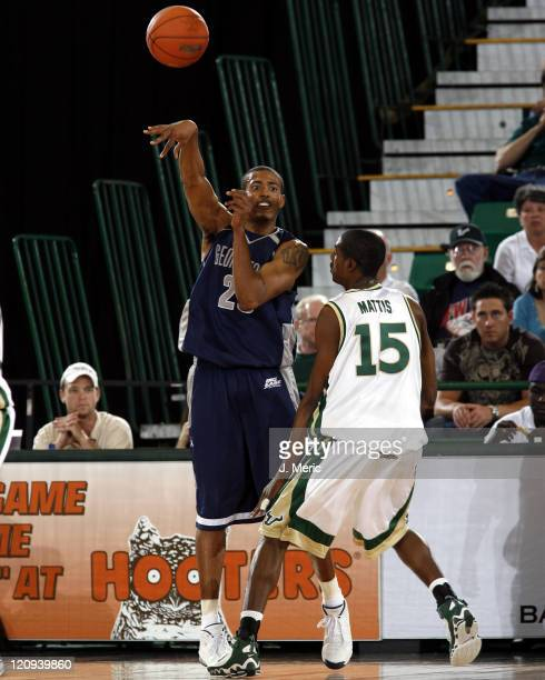 Georgetown's Josh Thornton makes a pass over South Florida's McHugh Mattis during Saturday night's game at the Sundome in Tampa, Florida on March 4,...