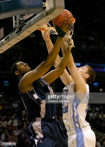 Georgetown's Patrick Ewing, Jr. Works on a layup against the University of North Carolina's Tyler Hansbrough in the first half. Georgetown defeated...