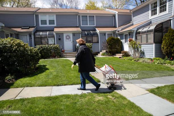 Georgette Penzavecchia delivers bags of groceries to seniors isolated in their homes on April 22, 2020 in Stamford, Connecticut. Local government and...
