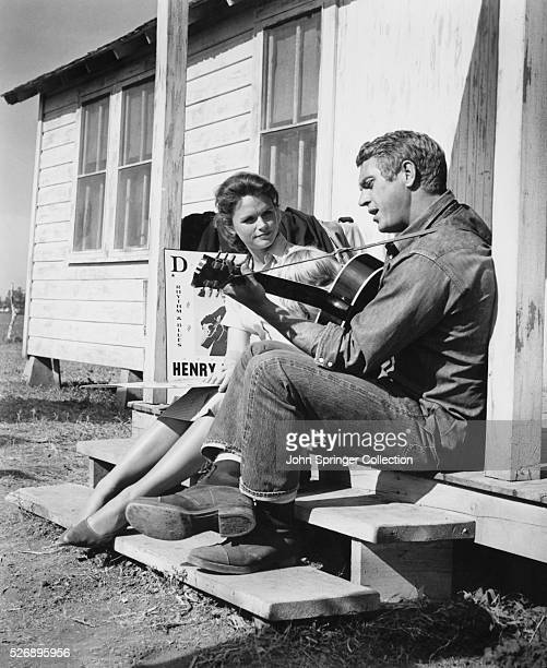 Georgette Thomas listens as husband Henry Thomas plays guitar in the 1965 film Baby the Rain Must Fall