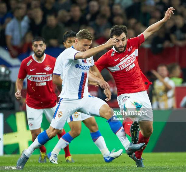 Georgi Dzhikiya of FC Spartak Moscow and Fyodor Chalov of PFC CSKA Moscow vie for the ball during the Russian Football League match between FC...