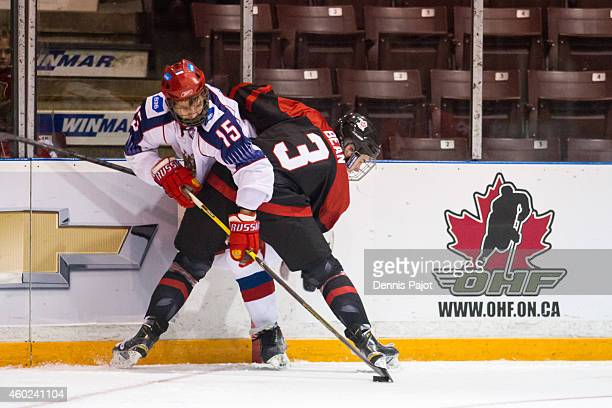 Georgi Ivanov of Russia battles for the puck against Jake Bean of Canada Black during the World Under17 Hockey Challenge on November 2 2014 at the...