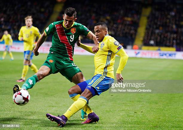 Georgi Kostadinov of Bulgaria and Martin Olsson of Sweden competes for the ballduring the FIFA 2018 World Cup Qualifier between Sweden and Bulgaria...