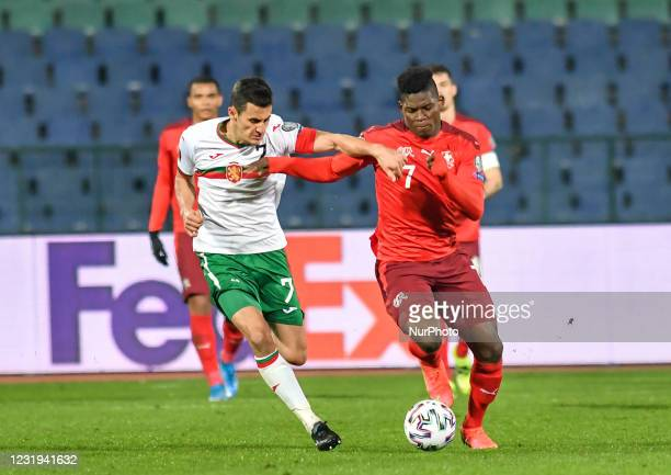 Georgi Kostadinov of Bulgaria is challenged by Breel Embolo of Switzerland during the FIFA World Cup 2022 Qatar qualifying match between Bulgaria and...