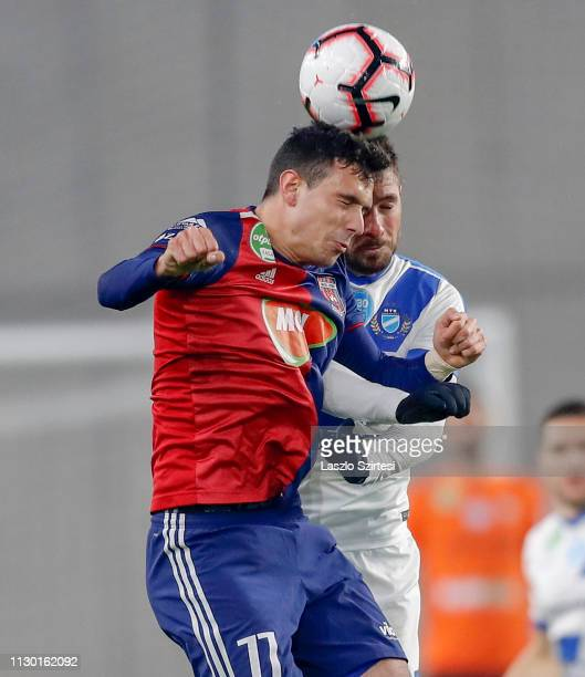 Georgi Milanov of MOL Vidi FC battles for the ball in the air with Bela Balogh of MTK Budapest during the Hungarian OTP Bank Liga match between MTK...