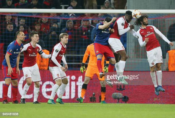 Georgi Milanov of PFC CSKA Moskva vies for the ball with Danny Welbeck and Mohamed Elneny of Arsenal FC during the UEFA Europa League quarter final...