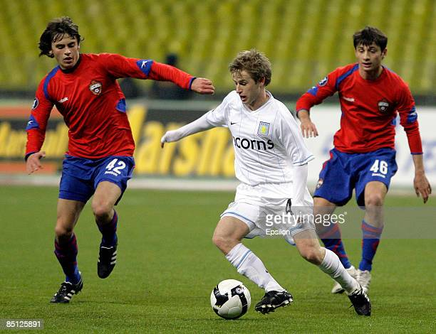 Georgi Schennikov and Alan Dzagoev of CSKA Moscow battles for the ball with Barry Bannan of Aston Villa during the UEFA Cup round of 32 second leg...