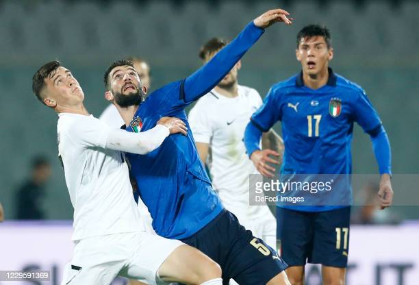 Georgi Tunjov of Estonia and Roberto Gagliardini of Italy battle for the ball during the International Friendly match between Italy and Estonia at...
