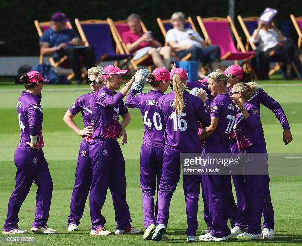Georgia Adams of Loughborough Lightning is congratulated on catchhing Bryony Smith of Surrey Stars during the Kia Super League match between...