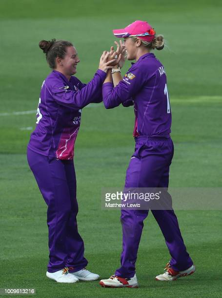 Georgia Adams of Loughborough Lightning is congratulated on catching Lizelle Lee of Surrey Stars during the Kia Super League match between...