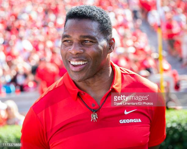 Georgia alum Herschel Walker on the sidelines during a game between Murray State Racers and University of Georgia Bulldogs at Sanford Stadium on...