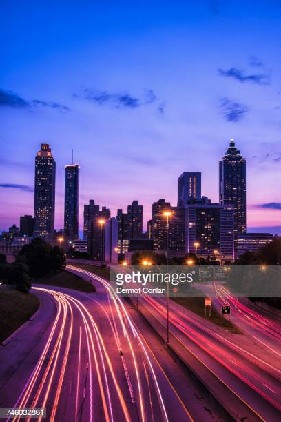 usa, georgia, atlanta, city skyline at dusk - atlanta skyline stock pictures, royalty-free photos & images
