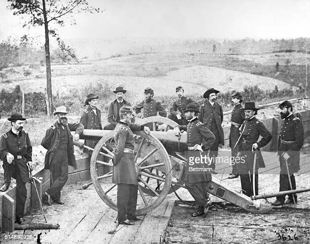 Atlanta with General Sherman leaning on breach of gun surrounded by staff