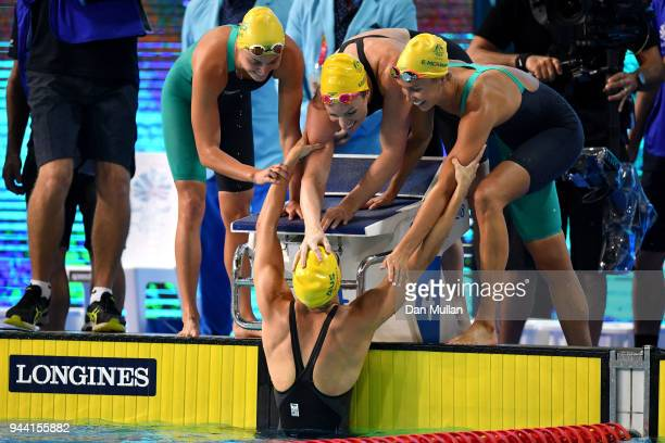Georgia Bohl Emma McKeon and Bronte Campbell of Australia celebrate victory in the Women's 4 x 100m Medley Relay Final on day six of the Gold Coast...