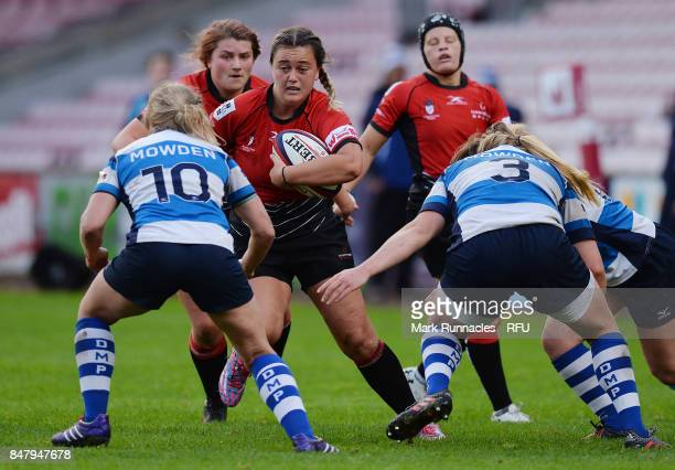 Georgia Bradley of GloucesterHartpury Women's RFC is tackled by Georgie Roberts of Darlington Mowden Park Sharks during the Womens Tyrrells Premier...
