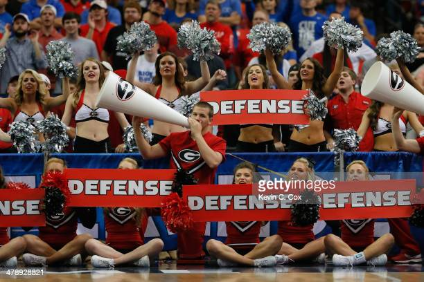 Georgia Bulldogs cheerleaders perform during the semifinals of the SEC Men's Basketball Tournament against the Kentucky Wildcats at Georgia Dome on...