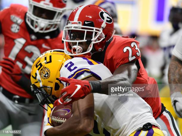 Georgia Bulldogs Defensive Back Mark Webb tackles LSU Tigers Wide Receiver Justin Jefferson during the SEC Championship game between the Georgia...