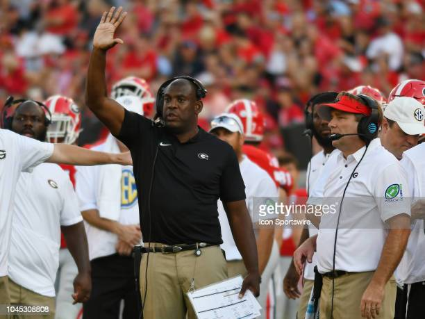 Georgia Bulldogs Defensive Coordinator Mel Tucker signals in a play as Georgia Bulldogs Head Coach Kirby Smart looks on during the game between the...