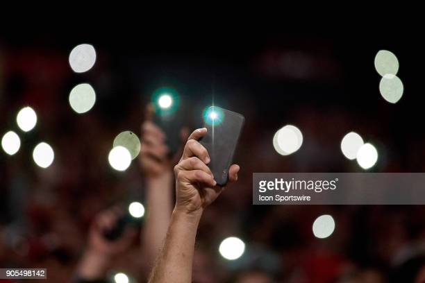 Georgia Bulldogs fans turn on their cell phone lights and hold them in the air at the start of the fourth quarter of the College Football Playoff...