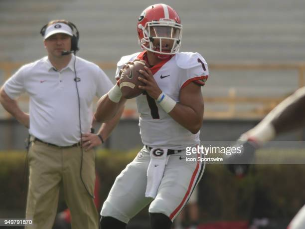Georgia Bulldogs Head Coach Kirby Smart wactches Georgia Bulldogs quarterback Justin Fields set up to pass during the Georgia Spring Game on April 21...