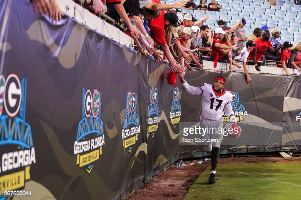 Georgia Bulldogs linebacker Davin Bellamy celebrates with fans after the game between the Georgia Bulldogs and the Florida Gators on October 28 2017...
