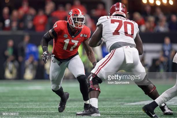 Georgia Bulldogs linebacker Davin Bellamy looks to battle with Alabama Crimson Tide offensive lineman Alex Leatherwood during the College Football...
