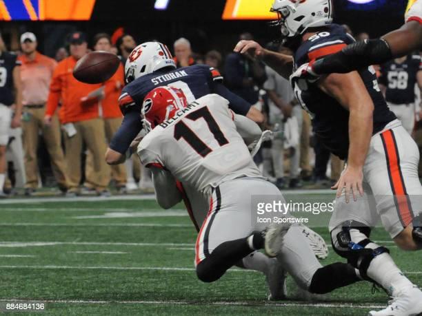 Georgia Bulldogs linebacker Davin Bellamy strips the ball from Auburn Tigers quarterback Jarrett Stidham during the SEC Championship game between the...