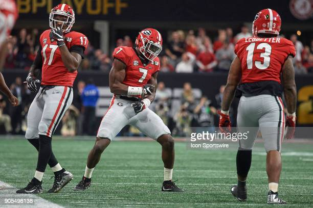 Georgia Bulldogs linebacker Lorenzo Carter celebrates with teammates after a play during the College Football Playoff National Championship Game...