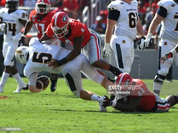 Georgia Bulldogs Linebacker Nolan Smith and Georgia Bulldogs Defensive Linemen Travon Walker sack Murray State Racers Quarterback Preston Rice during...