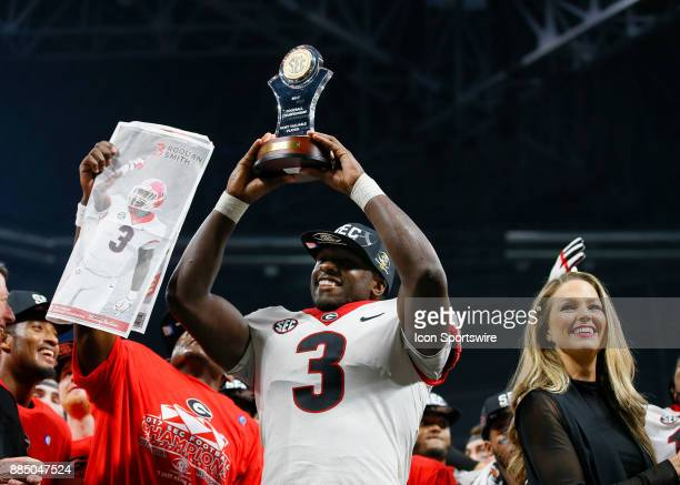 Georgia Bulldogs linebacker Roquan Smith reacts with his Most Valuable Player trophy at the conclusion of the SEC Championship Game between the...