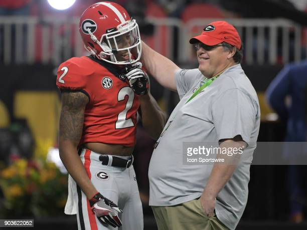 Georgia Bulldogs offensive coordinator Jim Chaney talks to Georgia Bulldogs wide receiver Jayson Stanley during warmups before the College Football...