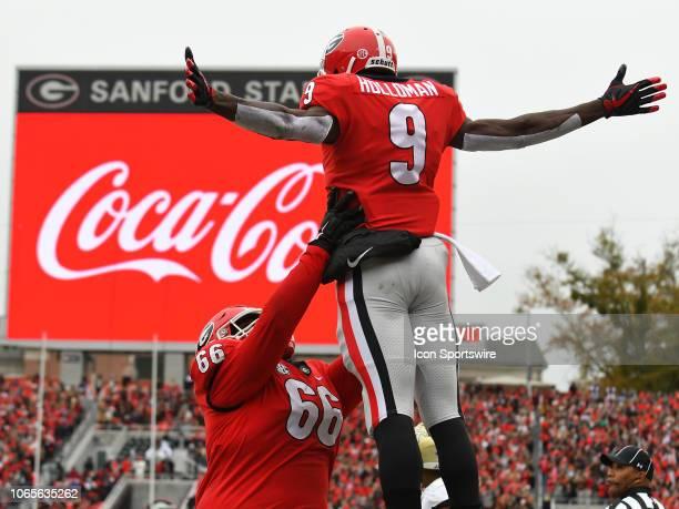 Georgia Bulldogs Offensive Linemen Solomon Kindley celebrates with Georgia Bulldogs Wide Receiver Jeremiah Holloman after a touchdown reception...