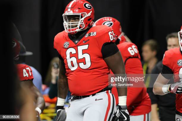 Georgia Bulldogs offensive tackle Kendall Baker comes out of the tunnel for the College Football Playoff National Championship Game between the...