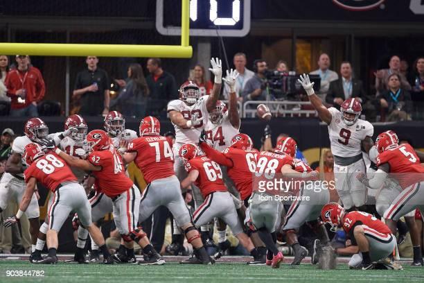 Georgia Bulldogs place kicker Rodrigo Blankenship kicks an extra point as Alabama Crimson Tide defensive lineman Raekwon Davis and Alabama Crimson...