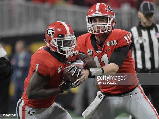 Georgia Bulldogs quarterback Jake Fromm hands the ball off to Georgia Bulldogs running back Sony Michel during the College Football Playoff National...