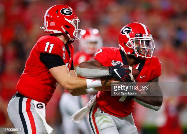 Georgia Bulldogs quarterback Jake Fromm hands the ball off to running back D'Andre Swift during the second half of the Notre Dame Fighting Irish v...