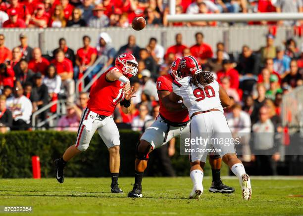 Georgia Bulldogs quarterback Jake Fromm passes as offensive tackle Isaiah Wynn blocks South Carolina Gamecocks defensive lineman Taylor Stallworth...