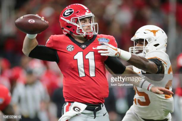 Georgia Bulldogs quarterback Jake Fromm passes under pressure from Texas Longhorns defensive back BJ Foster during the Allstate Sugar Bowl game...