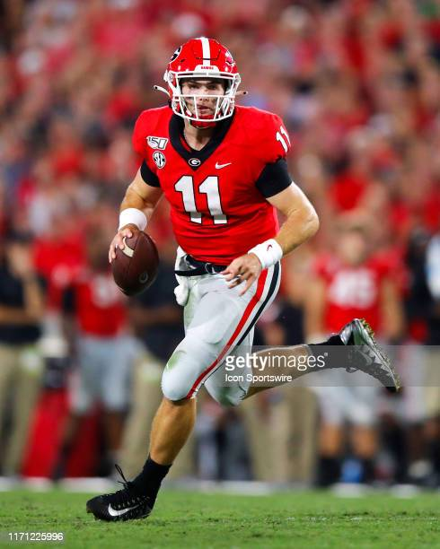 Georgia Bulldogs quarterback Jake Fromm rolls out to pass during the second half of the Notre Dame Fighting Irish v Georgia Bulldogs game on...