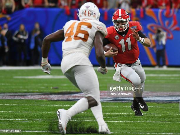 Georgia Bulldogs Quarterback Jake Fromm rushes the ball as Texas Longhorns Linebacker Joseph Ossai pursues during the Allstate Sugar Bowl between the...