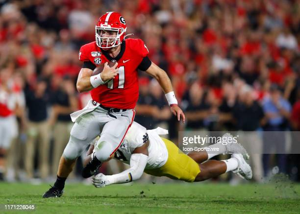 Georgia Bulldogs quarterback Jake Fromm scrambles as he is pressured by Notre Dame Fighting Irish defensive lineman Daelin Hayes during the second...