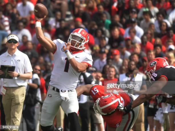 Georgia Bulldogs quarterback Justin Fields passes the ball as Georgia Bulldogs linebacker David Marshall applies pressure during the Georgia Spring...