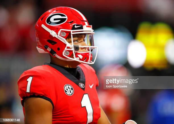Georgia Bulldogs quarterback Justin Fields warms up prior to the SEC Championship game of the Georgia Bulldogs v Alabama Crimson Tide at MercedesBenz...