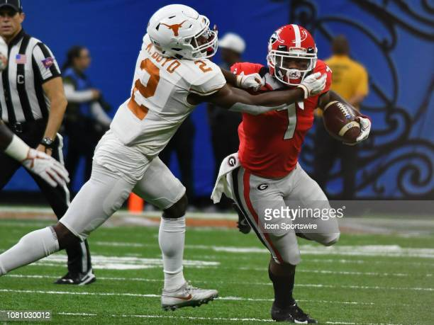 Georgia Bulldogs Running Back D'Andre Smith rushes the ball as Texas Longhorns Defensive Back Kris Boyd wraps him up during the Allstate Sugar Bowl...