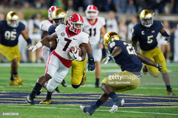 Georgia Bulldogs running back D'Andre Swift breaks a long run during the college football game between the Notre Dame Fighting Irish and Georgia...