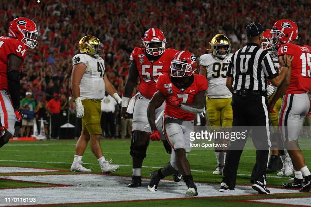 Georgia Bulldogs Running Back D'Andre Swift celebrates a touchdown run during the game between the Notre Dame Fighting Irish and the Georgia Bulldogs...