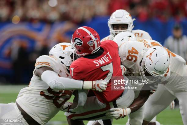Georgia Bulldogs running back D'Andre Swift is taken down by Texas Longhorns defensive lineman Charles Omenihu during the Allstate Sugar Bowl game...