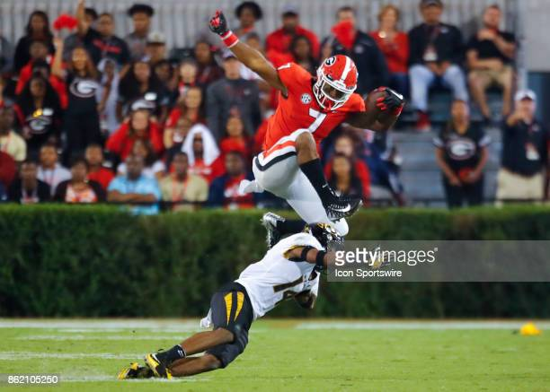 Georgia Bulldogs running back D'Andre Swift leaps over Missouri Tigers defensive back Adam Sparks in the second half of the Missouri Tigers v Georgia...